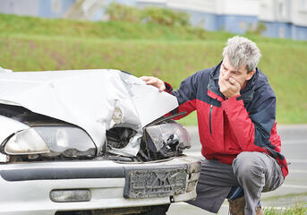 Car Accident Man With Hand Over Mouth