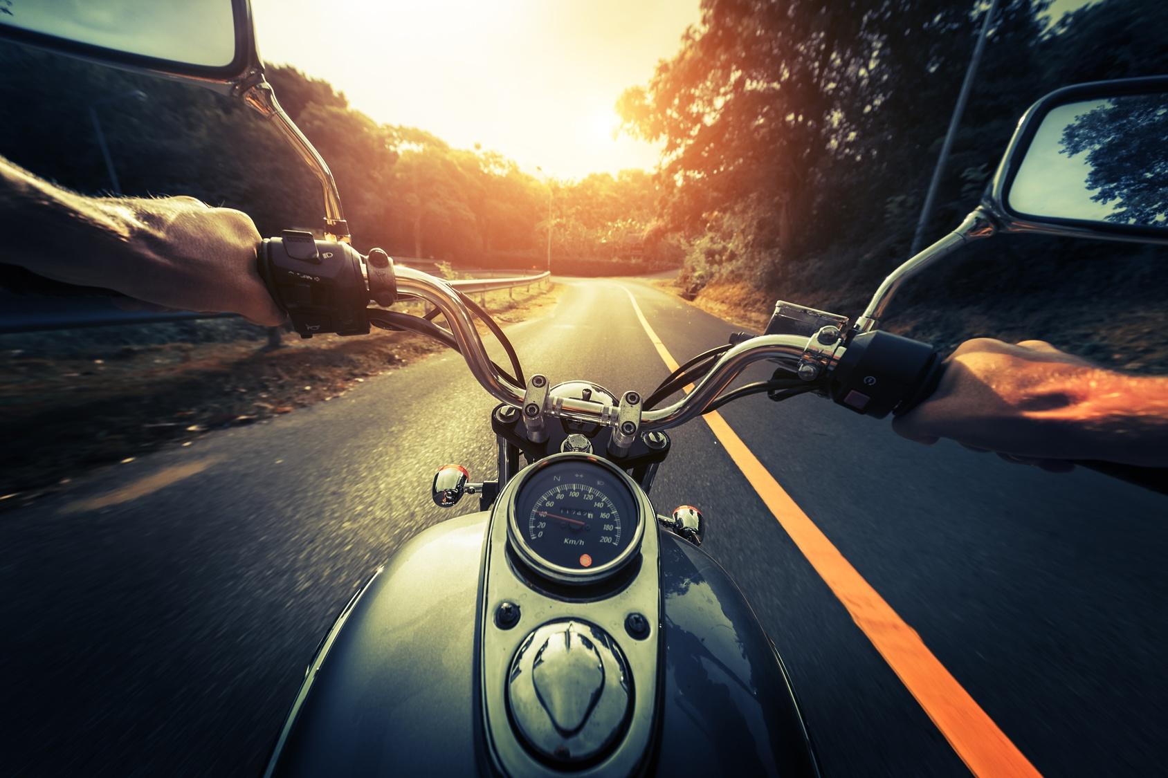 front end of motorcycle driving down a road