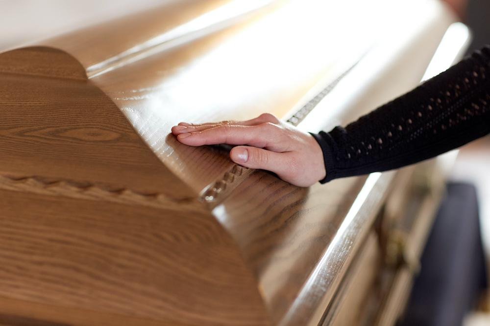 hand on casket