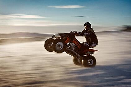 Person driving an ATV really fast which could result in needing an ATV accident attorney