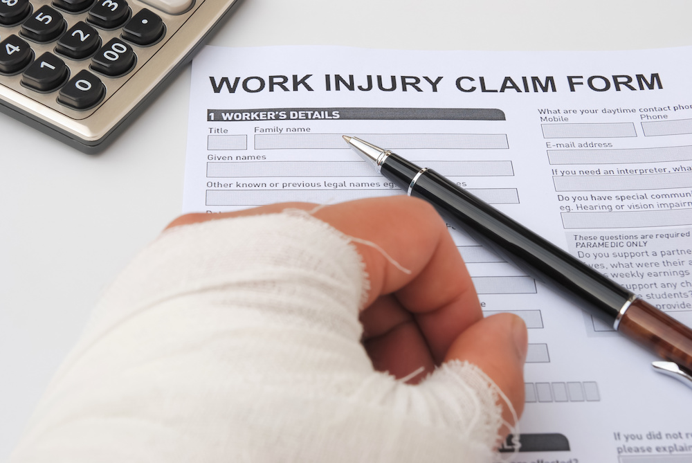 hand in cast with workers compensation form